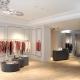 طراحی داخلی و دکوراسیون فروشگاه لباس و بوتیک مدرن سفید و کرم